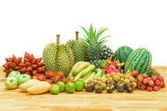 Fresh mixed fruits on wood table Royalty Free Stock Photo