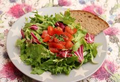 Mixed salad. A fresh mixed salad with a dressing of herbs Royalty Free Stock Images