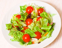 Fresh mixed salad leaves with cherry tomatoes Stock Photos