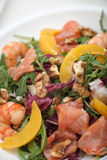 Fresh mixed salad with nuts, shrimps, salmon and Royalty Free Stock Image
