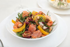 Fresh mixed salad with nuts, shrimps, salmon and Stock Photo