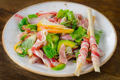 Fresh mixed salad with pancetta and pear royalty free stock photo