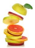 Fresh mixed slices of fruit stock photos