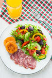 Fresh mixed vegetable salad, sliced sausage and cheese toasts Stock Images