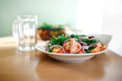 Fresh mixed vegetable salad of tomatoes, onions Royalty Free Stock Image
