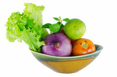 Fresh mixed vegetables. Fresh vegetables, cucumber, radish, tomato and lettuce in a colander Royalty Free Stock Images
