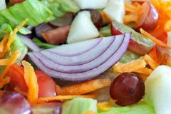 Fresh mixed vegetables fruit salad. Vegetarian food background and texture royalty free stock photography