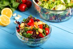 Fresh mixed vegetables salad in a bowl. On wooden background royalty free stock photography