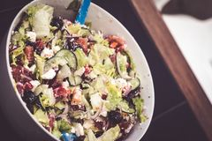 Fresh mixed vegetables salad in a bowl. Selective dark focus. Fresh mixed vegetables salad in bowl. Selective dark focus royalty free stock photos