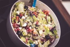Fresh mixed vegetables salad in a bowl. Selective dark focus. Fresh mixed vegetables salad in bowl. Selective dark focus royalty free stock photo