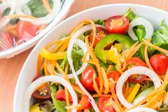 Fresh mixed vegetables salad. On table stock images