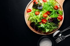 Fresh mixed vegetables salad. On a wooden plate royalty free stock photos