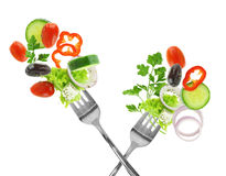 Fresh mixed vegetables. And silver forks isolated on white royalty free stock image