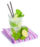 Fresh mojito cocktail and limes with mint Stock Image