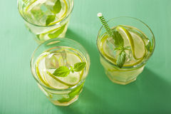 Fresh mojito cocktail over green background Royalty Free Stock Images