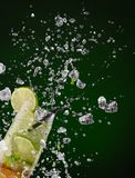 Fresh mojito drink with ice cubes and splashes Stock Images