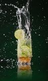Fresh mojito drink with ice cubes and splashes Stock Photography