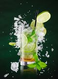 Fresh mojito drink with liquid and drift Royalty Free Stock Photos