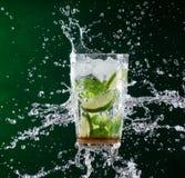 Fresh mojito drink with liquid splash Royalty Free Stock Photography