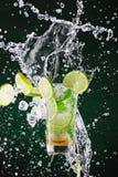 Fresh mojito drink with liquid splash stock images
