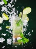Fresh mojito drink with liquid splash, freeze motion. Royalty Free Stock Photos