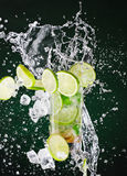 Fresh mojito drink with liquid splash, freeze motion. Royalty Free Stock Images