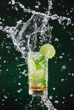 Fresh mojito drink with liquid splash, freeze motion. Royalty Free Stock Image