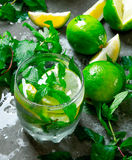 Fresh Mojito with lime and mint on the stone table. Stock Images