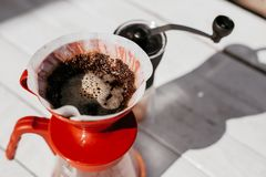 Fresh morning filter coffee in the dripper royalty free stock photo