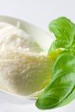 Fresh mozzarella. Fresh pieces of mozzarella cheese with fresh basil on a white plate Stock Photo