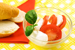 Fresh mozzarella. With tomatoes basil and baguette Stock Photos