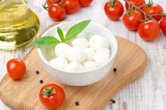 Fresh mozzarella in a bowl, cherry tomatoes and olive oil Stock Photo