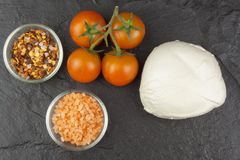 Fresh mozzarella cheese on slate board. Healthy diet meals. Preparing food for guests. Traditional meal Stock Photos