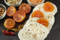 Fresh mozzarella cheese on slate board. Healthy diet meals. Preparing food for guests. Traditional meal Royalty Free Stock Photo