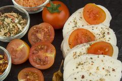 Fresh mozzarella cheese on slate board. Healthy diet meals. Preparing food for guests. Traditional meal Royalty Free Stock Photos