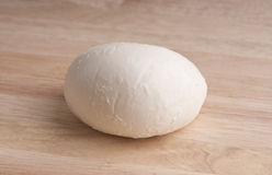 Fresh mozzarella on  chopping board of wood Stock Image
