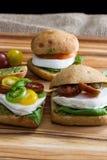 Fresh mozzarella tomato sandwiches with basil stock image