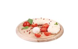 Fresh mozzarella and tomatoes on platter. Royalty Free Stock Photo