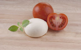Fresh mozzarella  and tomatoes wooden board Stock Photography