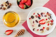 Fresh muesli with  fruits, honey and yogurt Stock Photo