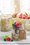 Fresh muesli with fruits and yogurt. On old wooden table Stock Image