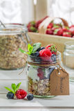 Fresh muesli with fruits and yogurt. On old wooden table Royalty Free Stock Photography