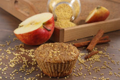 Fresh muffin with millet groats, cinnamon and apple baked with wholemeal flour, delicious healthy dessert Royalty Free Stock Photos