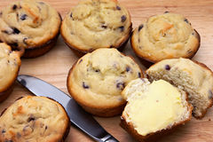 Fresh Muffins. Freshly baked and buttered muffins on board Royalty Free Stock Image