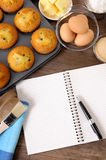 Fresh baked cakes with blank recipe book or cookbook, ingredients, copy space, vertical Royalty Free Stock Image