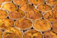Fresh muffins with candied fruit Royalty Free Stock Photo