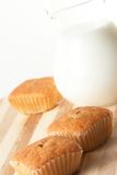 Fresh muffins with milk Royalty Free Stock Images