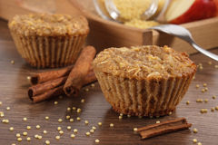 Fresh muffins with millet groats, cinnamon and apple baked with wholemeal flour, delicious healthy dessert Stock Photos
