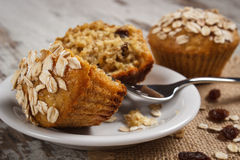 Fresh muffins with oatmeal baked with wholemeal flour on white plate, delicious healthy dessert Royalty Free Stock Photos