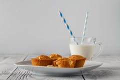 Fresh muffins on plate Stock Photo